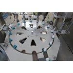 Machine de remplissage et de bouchage et de capsulage de répulsif anti-moustique liquide